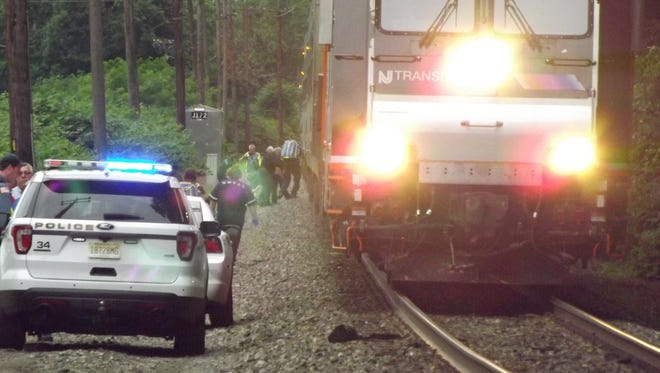Officials investigating at the scene where a person was struck and killed by a NJ Transit train in Oradell, NJ.