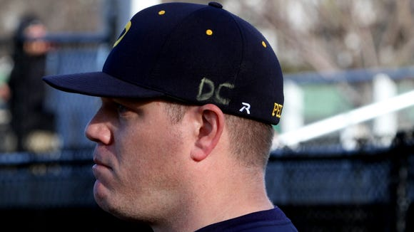 Pelham baseball coach Brian Leighton, and the entire Pelham team added the letters DC to their baseball caps for their game against Harrison April 5, 2017. The addition to their caps was in honor of Eastchester High School baseball coach Com Cecere, a Pelham High School graduate, who died this past Saturday.