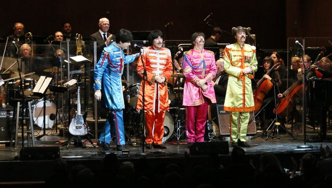 Philly Pops music director Michael Krajewski applauds the members of Classical Mystery Tour.