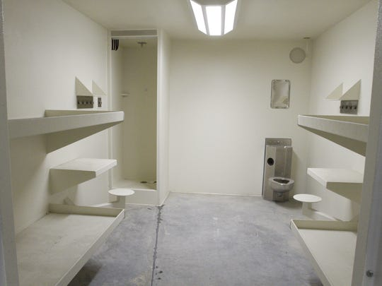 Showers in the cells which will hold four inmates allow more privacy than the community showers in the older portion of the county jail.