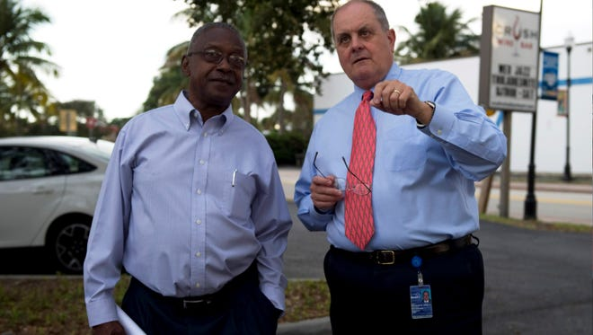 Former Stuart City Commissioner and Mayor James Christie Jr. (left) and City Manager Paul Nicoletti talk during the 2013 public tour of the Triangle property in downtown Stuart. Nicoletti was hired to help Indiantown transition into an incorporated village.