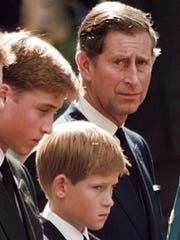 Britain's Prince Charles casts a concerned glance toward