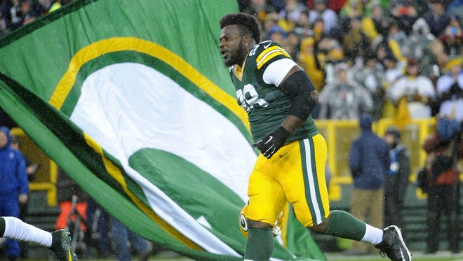 Green Bay Packers defensive tackle Letroy Guion (98) takes the field before the game against the Chicago Bears at Lambeau Field.