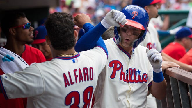 Philadelphia Phillies left fielder Rhys Hoskins (17) celebrates with catcher Jorge Alfaro (38) after hitting a three RBI home run during the third inning against the Milwaukee Brewers at Citizens Bank Park.