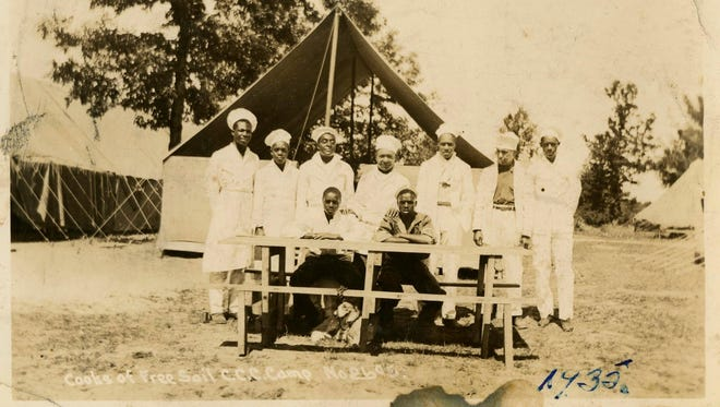 Cooks of the Free Soil Civilian Conservation Corps are photographed in 1935 in Michigan. UM has acquired a trove of photos capturing a place and time largely overlooked by history: black CCC camps during the Great Depression. The photos are the only known images of the state's segregated, all-black camps.