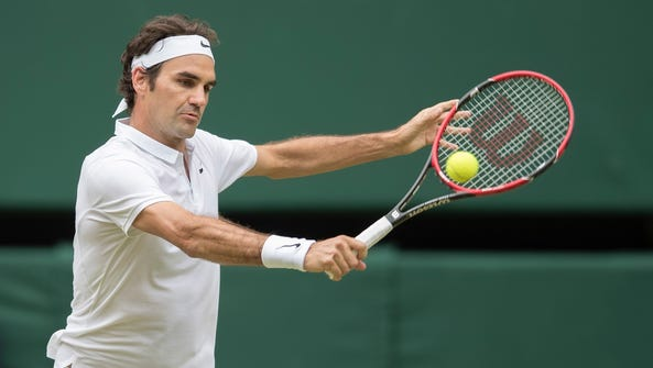 Roger Federer (SUI) in action during his match against