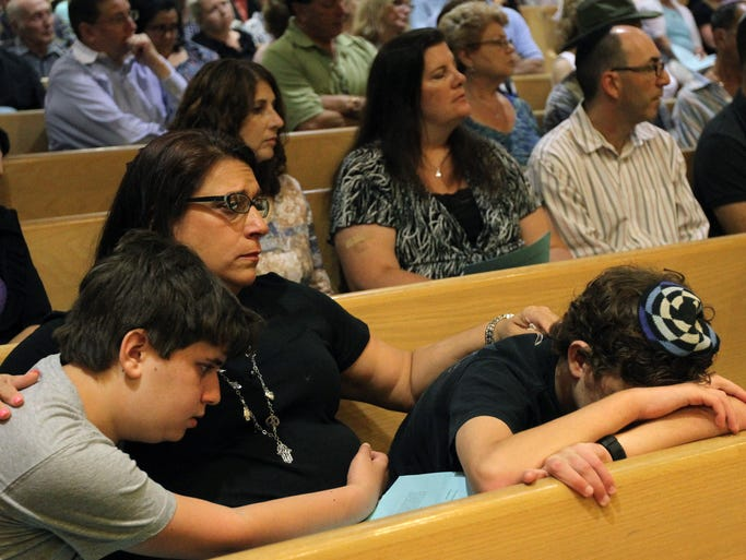 Robyn Stern, comforts her sons Erik 12, left, and Alex ,14, during memorial service at Temple Beth Ahm in Aberdeen, for the three teenagers that were kidnapped and killed in Israel.  Wednesday July,2, 2014, Aberdeen.  Photo by Robert Ward