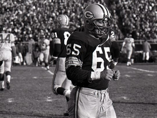 Green Bay Packers linebacker Tom Bettis (65) comes