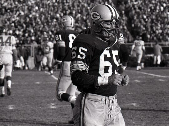 Green Bay Packers linebacker Tom Bettis (65) comes off the field during the NFL championship game against the New York Giants at new City Stadium on Dec. 31, 1961. The Packers won 37-0.