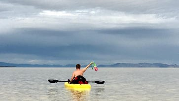 A kayaker relaxes on March 19 on the lake that has formed out on the Black Rock Desert.