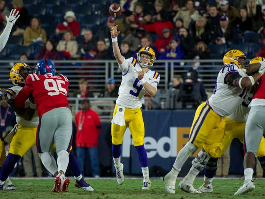 Nov 16, 2019; Oxford, MS, USA; LSU Tigers quarterback Joe Burrow (9) passes against the Mississippi Rebels during the first half at Vaught-Hemingway Stadium. Mandatory Credit: Justin Ford-USA TODAY Sports