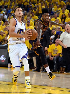 Golden State Warriors guard Stephen Curry (30) drives to the basket against Cleveland Cavaliers guard Iman Shumpert (4) during the second quarter in Game 1 of the NBA Finals at Oracle Arena.