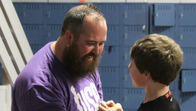 """Jeremy """"P.J."""" Byler, youth pastor at Erin Church of the Nazarene, greets one of the students in the Fuse program."""