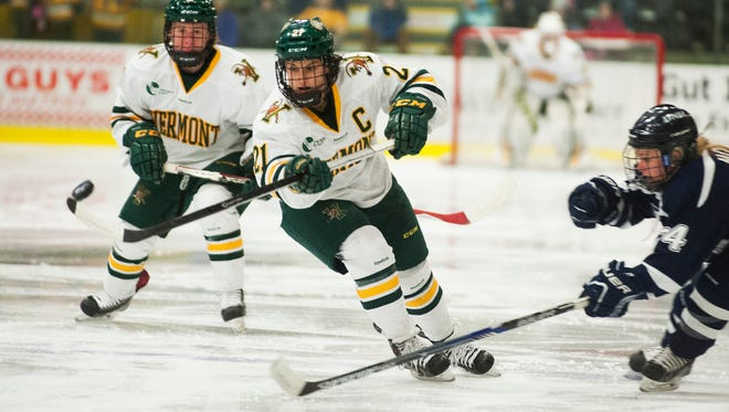 Catamounts forward Amanda Pelkey (21) plays the puck during the women's hockey game between the New Hampshire Wildcats and the Vermont Catamounts at Gutterson Fieldhouse on Friday night.