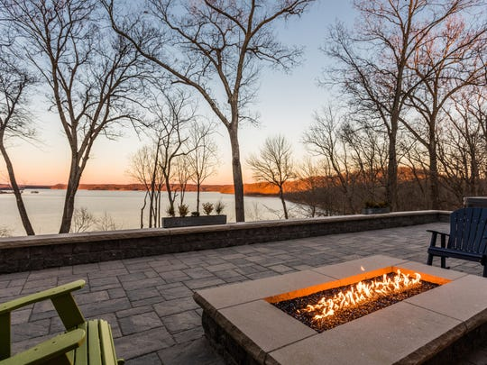 An outdoor fireplace takes the chill off.