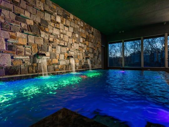 An indoor pool features waterfalls.