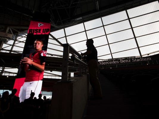 Members of the media are given a tour of the Mercedes-Benz Stadium, the new home of the Atlanta Falcons football team and the Atlanta United soccer team, as it nears completion in preparation for its opening in Atlanta, Tuesday, Aug. 15, 2017. The stadium will open to the public for the first time at an Aug. 26 Falcons preseason game. (AP Photo/David Goldman)