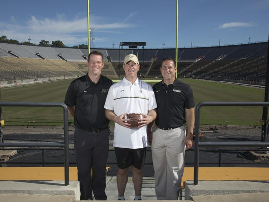 Purdue head coach Jeff Brohm, center, with brothers Brian, left, and Greg. Greg Brohm is executive director of administration/chief of staff for the football program.. Brian Brohm is co-offensive coordinator and quarterbacks coach