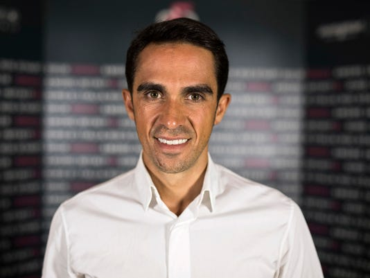 Spanish former professional cyclist Alberto Contador poses for a photo during an interview with The Associated Press in Jerusalem, Monday, Sept. 18, 2017. The Giro d'Italia cycling race announced on Monday the details of next year's start in Jerusalem, which will mark the first time a cycling Grand Tour is held outside of Europe. (AP Photo/Dan Balilty)