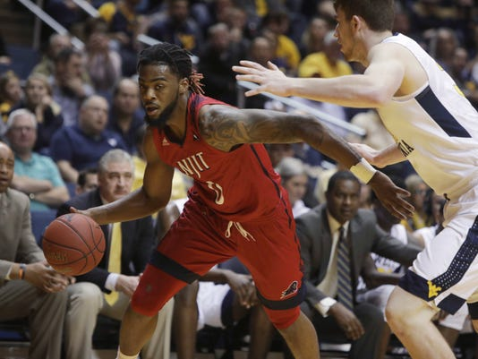 NJIT forward Abdul Lewis (0) drives to the basket while defended by West Virginia forward Logan Routt during the first half of an NCAA college basketball game Thursday, Nov. 30, 2017, in Morgantown, W.Va. (AP Photo/Raymond Thompson)