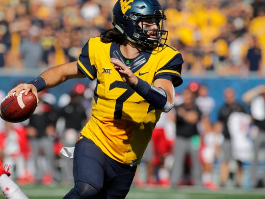 FILE - In this Oct. 14, 2017, file photo, West Virginia quarterback Will Grier (7) looks to pass against Texas Tech during an NCAA college football game in Morgantown, W.Va. While the Sooners are still the preseason favorite again, there are also high expectations for Grier, the preseason Big 12 offensive player of the year who threw 34 touchdowns and 3,490 yards in his injury-shortened WVU debut.(AP Photo/Raymond Thompson, File)