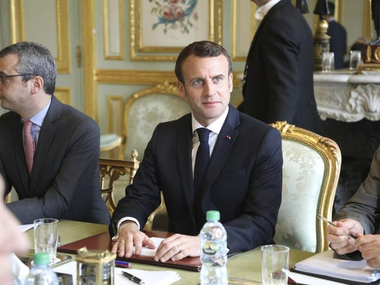 French President Emmanuel Macron flanked by Elysee general secretary Alexis Kohler, left, holds a meeting at the Elysee presidential Palace, in Paris.