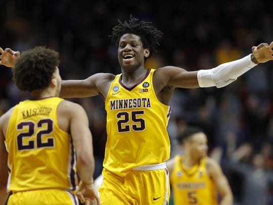 Minnesota center Daniel Oturu (25) celebrates with