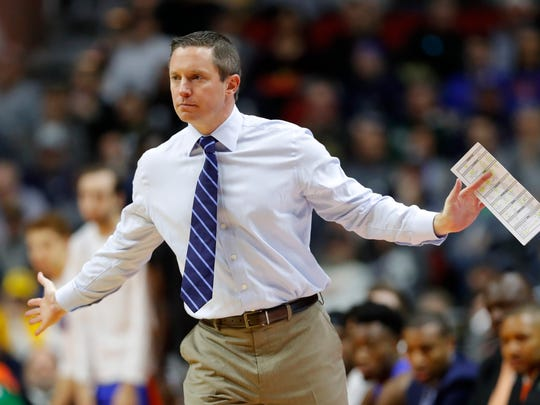 Florida coach Mike White directs his team against Nevada.