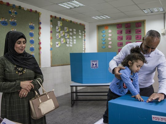 A family votes during general elections in a predominantly