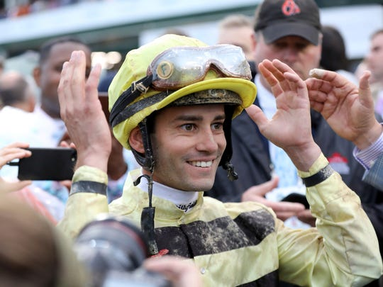Jockey Flavien Prat reacts learning he won the 145th running of the Kentucky Derby horse race when Maximum Security was disqualified at Churchill Downs Saturday, May 4, 2019, in Louisville, Ky. (AP Photo/Greg Payan)