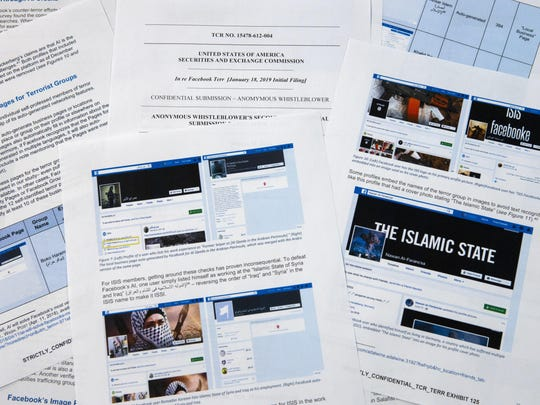 Pages from a confidential whistleblower's report obtained by The AP are photographed Tuesday, May 7, 2019, in Washington. Facebook likes to give the impression that it's stopping the vast majority of extremist posts before users ever see them., but the confidential whistleblower's complaint to the SEC alleges the social media company has exaggerated its success. Even worse, it shows that the company is making use of propaganda by militant groups to auto-generate videos and pages that could be used for networking by extremists.