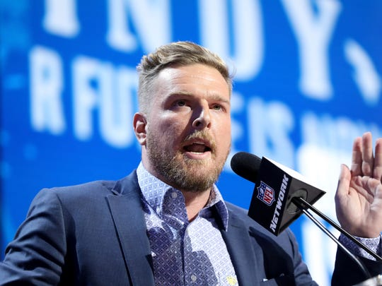 Former Indianapolis Colts player Pat McAfee announces the Colts' third round pick at the NFL football draft, in Nashville, Tenn. on Friday, April 26, 2019. (AP Photo/Gregory Payan)