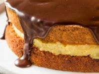 Chocolate ganache cascades invitingly down the sides of a Boston cream pie
