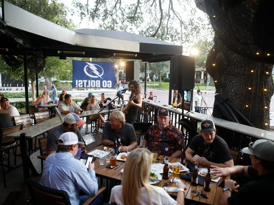 Patrons have dinner at Irish 31 on Friday, the first day of full-capacity seating, in Tampa, Fla.
