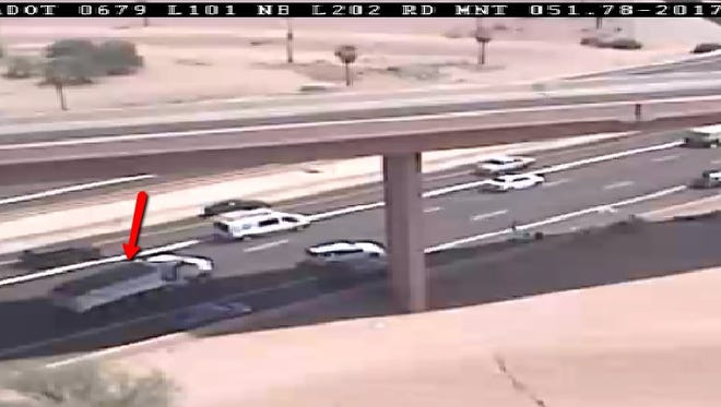 This image captured by a freeway camera shows a vehicle involved in a crash that closed eastbound Loop 202 in Tempe on Aug. 31, 2017.