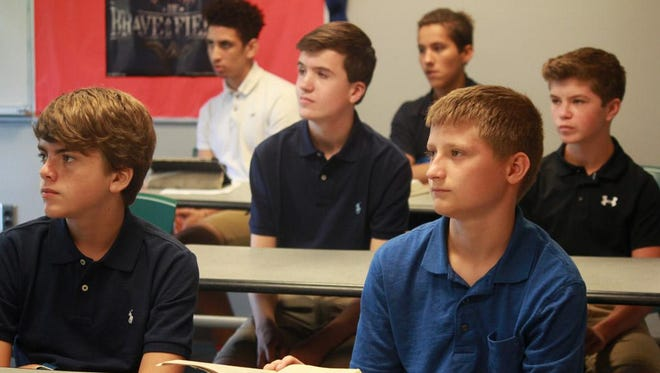 Delmarva Christian freshman, from left, row one, Dillion Koster and Zach Desiderio. row two, Bo McGregor and Deklan Mullaney. and row three, Colby Apgar and Drew McCullough listend to Delmarva Christian Study Skills teacher Angel Magee on their first day.
