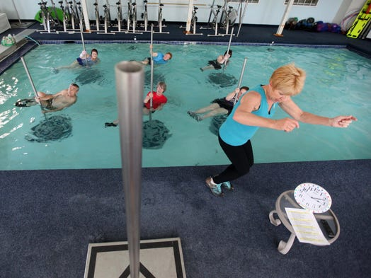 Joanne Randell, owner of Aquatics Is, teaches a class of aquatic pole fitness in the swimming pool of Ashbridge Manor in Downingtown, Pa., April 16.