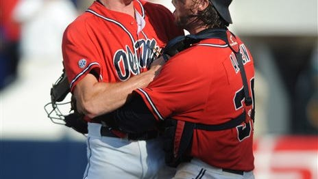 Ole Miss' Aaron Greenwood (44) celebrates with Mississippi's Will Allen (30) after striking out  Washington's Alex Schmidt (27) to win the game at the NCAA Oxford Regional at Oxford-University Stadium on Sunday, June 1, 2014. Mississippi won 2-1.  (AP Photo/Oxford Eagle, Bruce Newman)