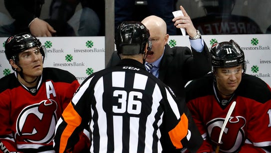 Devils coach John Hynes argues with official Dean Morton