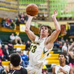 CMR's Trevor Pepin leaps to dunk the ball against Helena High School earlier this season.