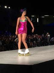 A model wears roller-skates on the runway at a Julia Clancey show at Style Fashion Week in Los Angeles on Oct. 13, 2016.