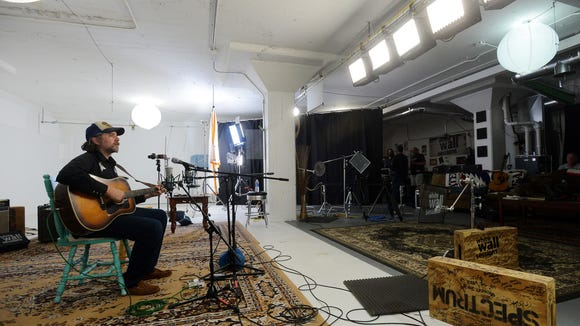 Tom VandenAvond warms up before a recording session Friday for the White Wall Sessions in Sioux Falls, June 1, 2015.