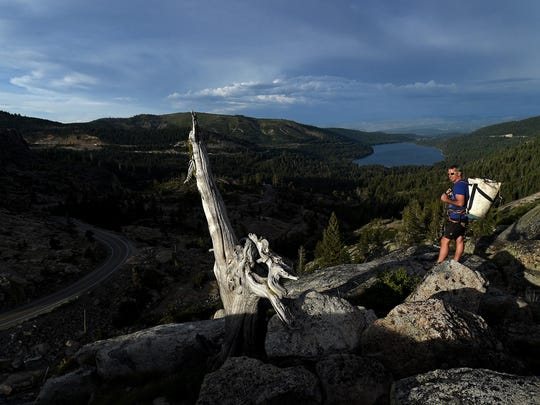Climber Brian Biega looks out at Donner Pass near Truckee on June 30, 2015.
