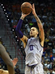 Lakers forward Kyle Kuzma shoots against the Portland