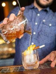 Head Bartender Sam Nelis creates a winter cocktail with Caledonia Spirits at Waterworks Food + Drink on Tuesday, December 8, 2015.