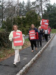 Millburn Education Association members push for a contract negotiation on April 25, 2018.