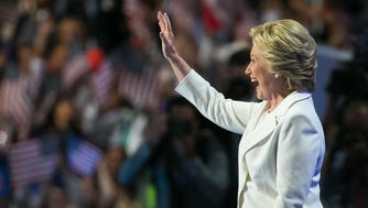Hillary Clinton greets the crowd as she arrives for her speech at the Democratic National Convention in Philadelphia on July 28, 2016.