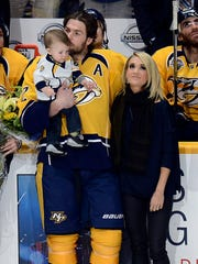 Predators center Mike Fisher kisses his son, Isaiah,