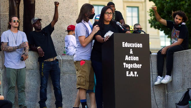 """John Keating offers support to Sunshine Clemons, president of Black Lives Matter Springfield, as she speaks about the death of George Floyd at the """"Manifesting Our Momentum"""" event that included U.S. Sen. Dick Durbin, as well as other community, faith and elected officials Sunday, June 7, 2020."""