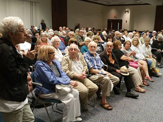 Questions are being asked during the meeting Monday night at the Oak Park Jewish Community Center concerning the outcome of the facility.